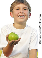 Healthy Lifestyle Boy with apple in his palm - Child holding...