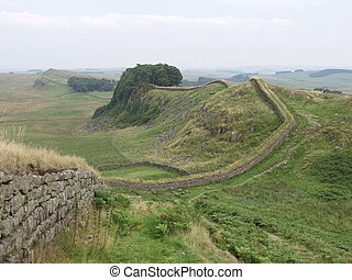 Hadrian's Wall - Hadrian's wall was build by the Romans in...