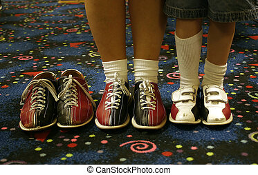 Missing - Three pair of bowling shoes Two being worn, one...