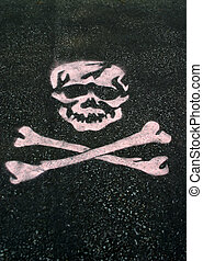Stenciled Skull - A skull stenciled on asphalt