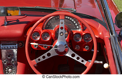 Dashboard - Red trimmed car with steering wheel and...