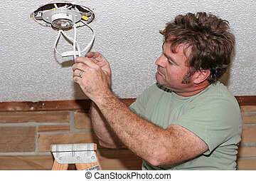 Electrician Checking Switches - an electrician checking the...