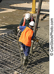 Commercial Cementing - Workers standing on thick steel mesh...