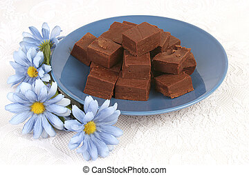 Fudge and Flowers - homemade fudge on a blue plate with blue...