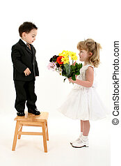 Boy Girl Flower Cute - Toddler boy in suit giving flowers to...