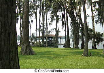 Cypress Lake - A boat house on the shore of Cypress Lake in...