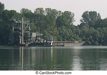 Dredging facility in the river
