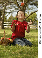 Child throwing up an apple