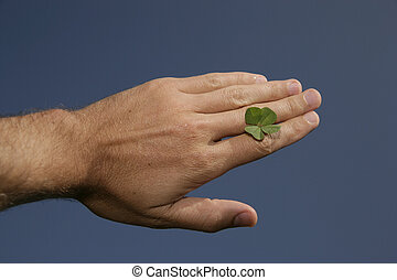 four-leaved clover - Hand with fourleaf