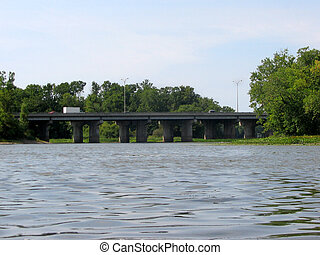 Highway bridge - A highway bridge passing over a river,...