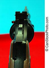 cocked revolver - a cocked revolver handgun with the focus...