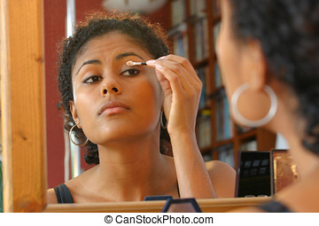 Applying eyeshadow - Beautiful brazilian girl applying...