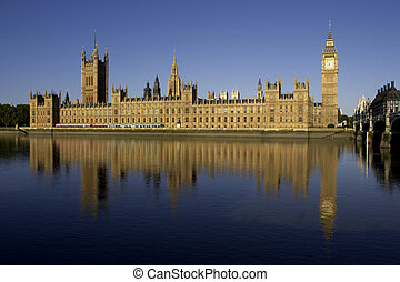 Houses of parliament reflected in the river thames