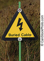 Hazard sign - Yellow buried electrical cables warning sign...