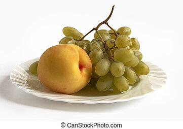 isolated grape and peach on white plate