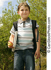 Education - Off to school - Pupil walking to school on a...