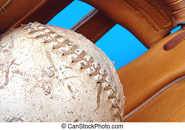 softball - focus on a well worn softball with a fade into a...