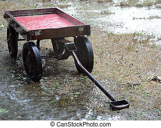 Red Wagon Rain 1 - Red wagon in the rain