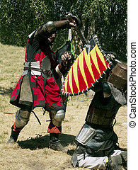 Medieval Warriors - Combatants employ medieval weapons at...
