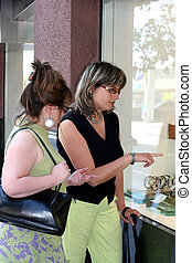 Girl window shopping - 2 women window shopping