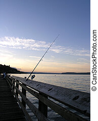 Sunset Fishing - The rail of this public pier has notches in...