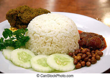 Nasi Lemak - Rice boiled in coconut milk, accompanied by...
