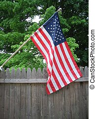 American flag on fence.