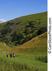 walking in hills - Group of people walking in hills
