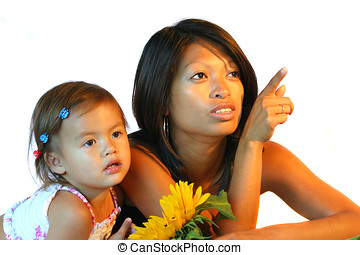 Mother and daughter - Attractive philippine woman with her...