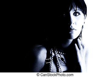 Expressive Teen Girl In Blue Tones Shot in studio over black...