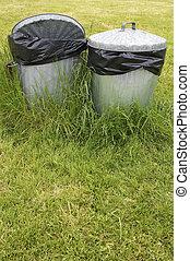 waste bins in grass