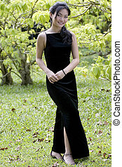 Outdoor Model 3 - a beautiful young asian woman in a black...