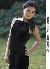 Outdoor Model 10 - A beautiful young asian woman poses in an...