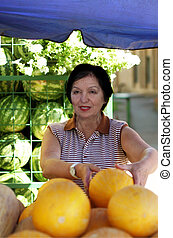 Grandma with melons