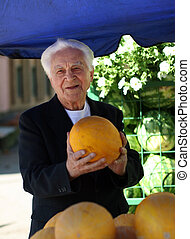 Old man with melon