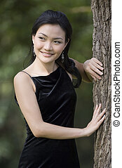 Outdoor Model 15 - A beautiful young asian woman poses in a...