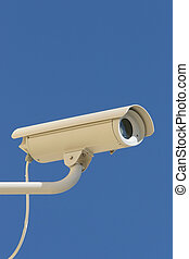 security camera - security / surveillance camera against a...