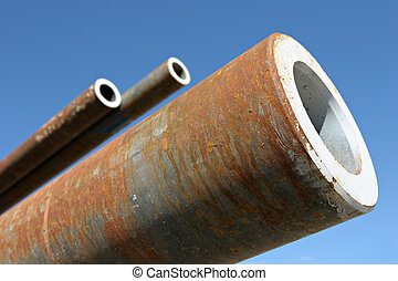 steel pipes, close up perspective against blue sky