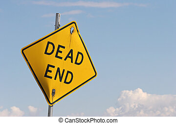 dead end sign, broken down and crooked against a blue sky