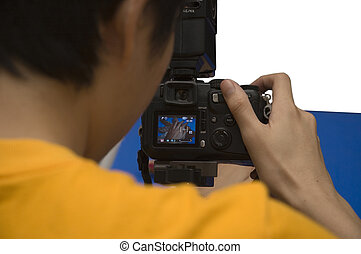 Photographing - A photographer preparing a shot