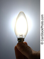 New idea! - Holding lighting bulb. Conceptual image: always...