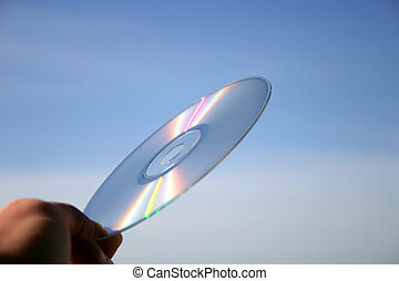 Compact disc close-up against the sky background