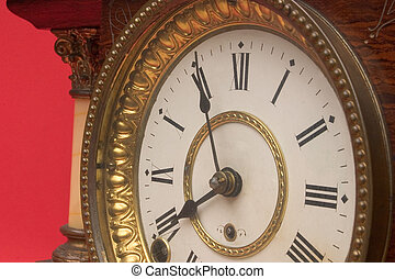 Antique clock - The face of an old chiming mantle clock