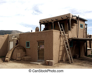 Ladders and Steps - Adobe construction in Taos, New Mexico