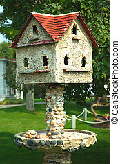 Stone Bird House - A vintage birdhouse and bird bath made of...