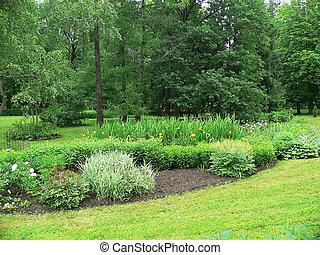Spring garden - Flowerbed in garden at spring