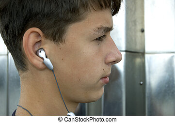 boy or teen with headphones - teen listen music on mp3...