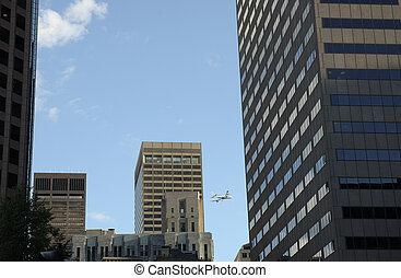 flight behind skylines - passengers airplane behind skylines...