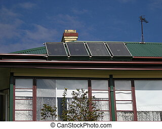 Energy solutions - Solar panels on house roof.