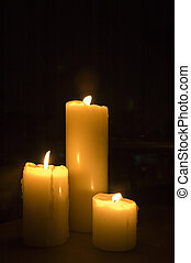 Romantic Candles - Three romantic candles lighted